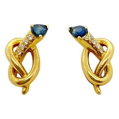 Carrera Y Carrera 18 Karat Gold Knot Earrings with Diamonds and Blue Sapphires