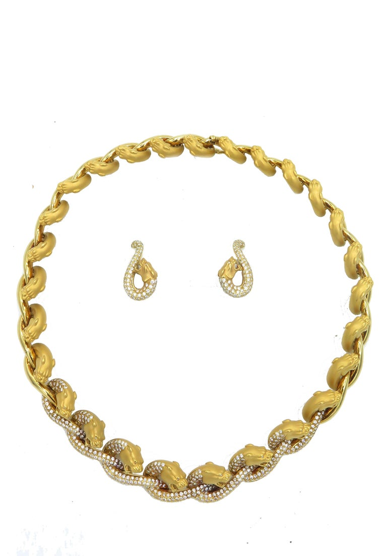 If you love the distinct golden glow of Spanish gold, you will lust after this magnificent Cerrera y Cerrera necklace and earring set. Fashioned in the Carrera y Carrera iconic tiger design, 18k yellow gold and precious diamonds come together In