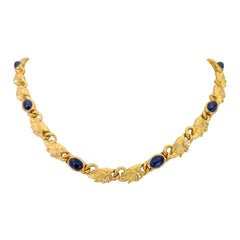 Carrera y Carrera 18k Yellow Gold Elephant Necklace with 10.85Ct. Blue Sapphires