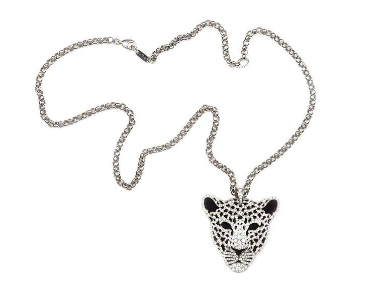 18k gold diamond and onyx leopard pendant necklace. Signed.