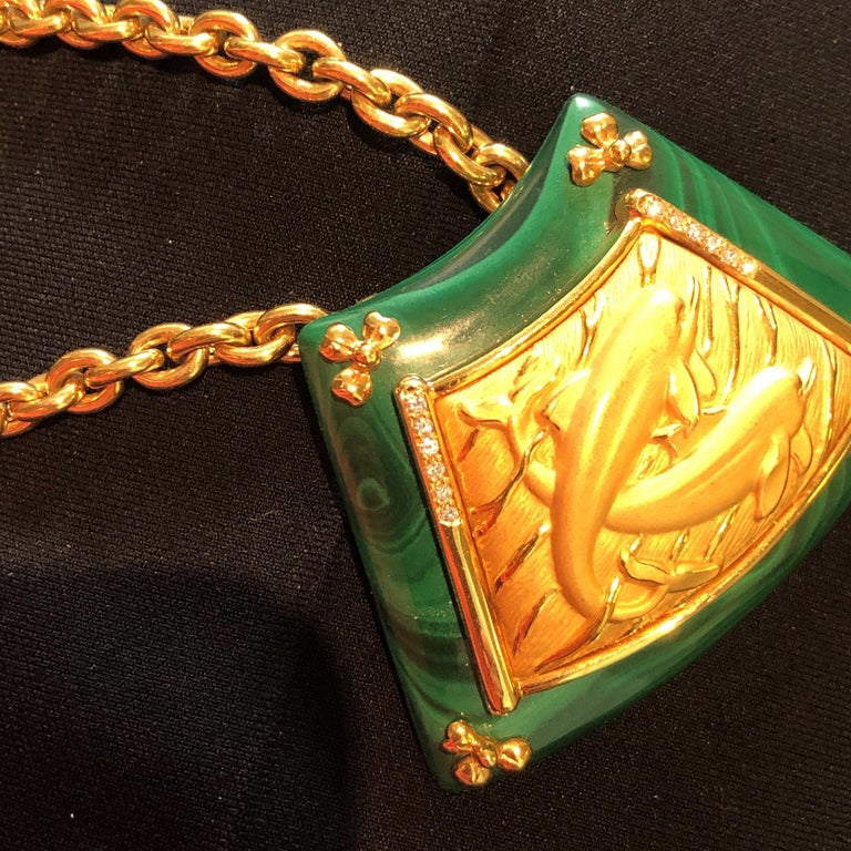 18 K Yellow Gold Malachite Diamond Carrera Necklace Dolphins and Diamonds in a sea of Malachite Chain is stamped 227284 and 750 and CC Delicate Gold Flowers on each corner of the Malachite   Necklace is 11 inches long Gorgeous Chain is removable and