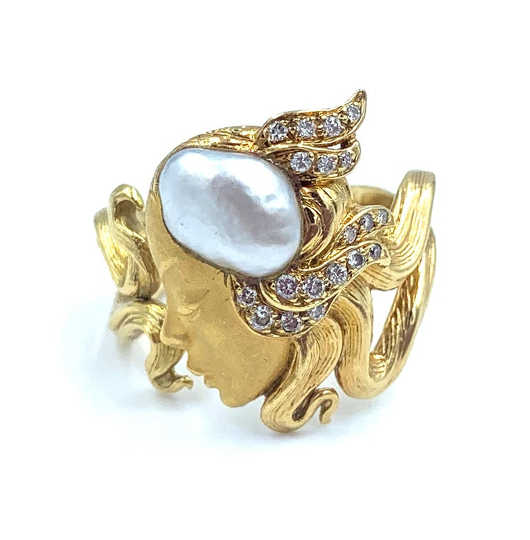 Beautiful Maidenform 18 kt yellow gold ring adorned with a pearl and diamonds by the famous Spanish Jewelry House of Carrera y Carrera.  Size 8.5  0.20cts of diamonds