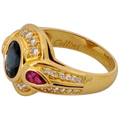 CarreraYCarrera 18kt Gold Ring with 1.65Ct Oval Blue Sapphire, Ruby and Diamonds
