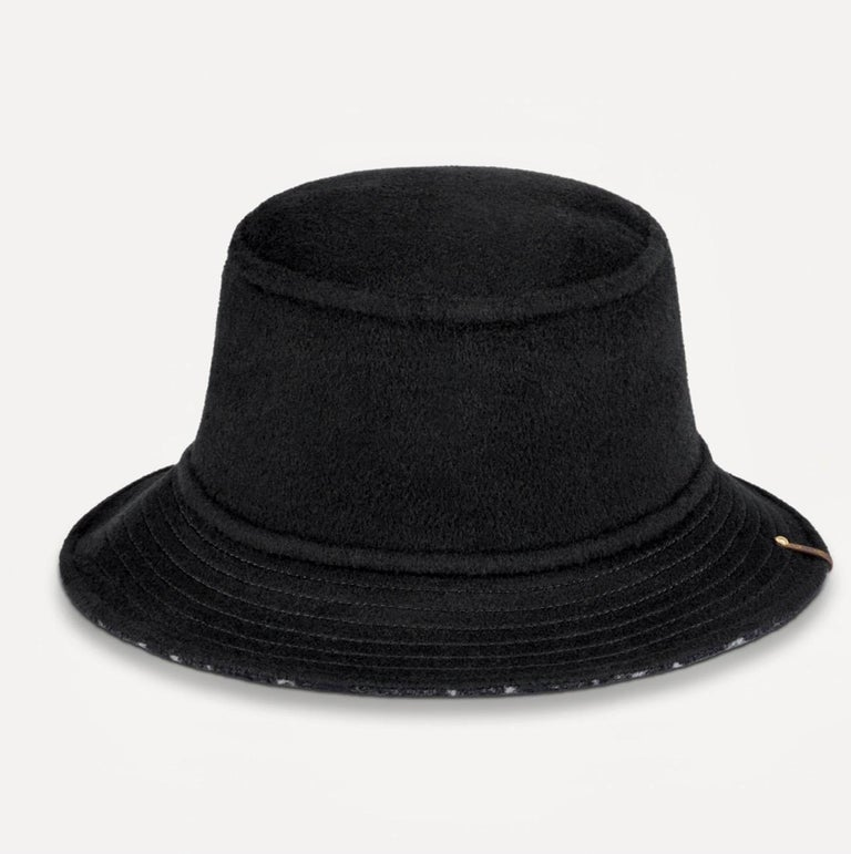CARRY ON BOB, Reversible Black Bob Wool Bucket Hat Size Small, Brand New In Box and Ribbon The Carry On Bob hat is a new accessory introduced for Spring-Summer 2021. This reversible style features a Monogram motif on one side and solid color on the