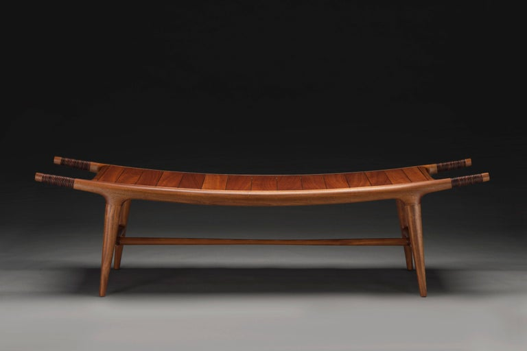 Contemporary American furniture maker Carter Hopkins' Khafra Bench was made in 2015. This handcrafted sapele wood bench was designed and made with form and function in mind. The seating is curved to create a perfect seating for two while it's