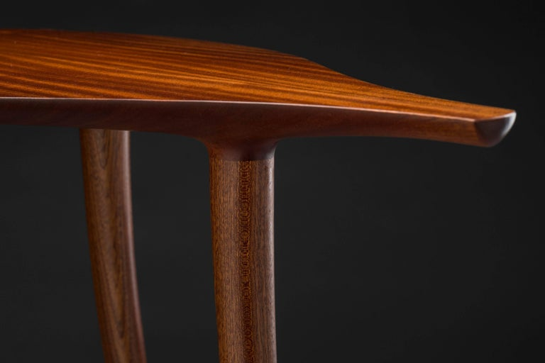 Contemporary American furniture maker Carter Hopkins' Sapele High Table was made in 2016. He wanted to properly shape the joints, while eliciting elegance and care for every component of the piece. In this case, that meant hand shaping. At 36 inches