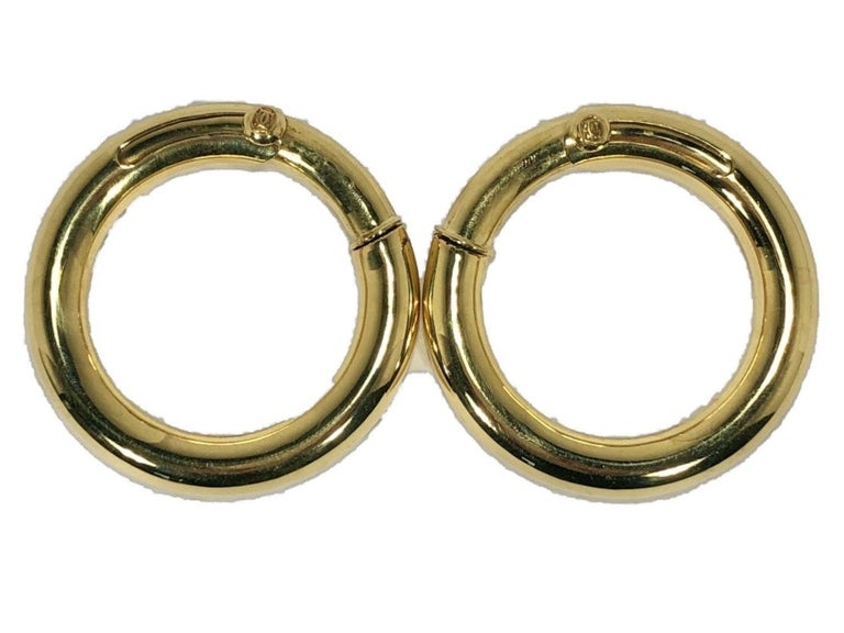 This lovey, classic pair of Cartier 18k high polish hoop earrings are outstanding in quality and size. At 1 5/8 inch outer diameter and a thickness of 6.5mm for the hoop itself, they are not demure.  These are perfect for the lady who does not have