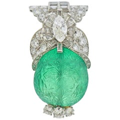 Cartier approximately 65 Carat Carved Colombian Emerald Diamond Platinum Brooch