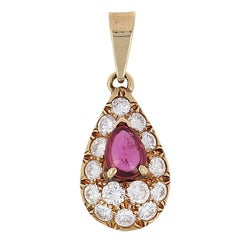 Cartier 1.40 Carat Pear Cabochon Ruby and Diamond Pendant, 18K Gold Designer