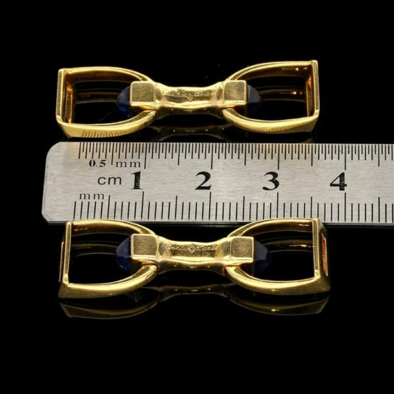 Cartier 18 Carat Gold Stirrup Cufflinks with Sapphire Sugar Loaf, circa 1935 In Good Condition For Sale In London, GB