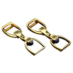 Cartier 18 Carat Gold Stirrup Cufflinks with Sapphire Sugar Loaf, circa 1935