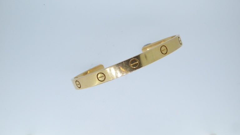 Cartier 18 Carat Yellow Gold Love Cuff Bangle Bracelet In Good Condition For Sale In London, GB