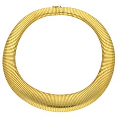 Cartier 18 Carat Yellow Gold Wide Flattened Gas-Pipe Style Necklace, circa 1950s