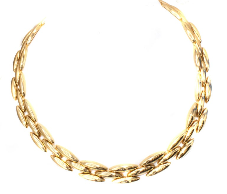 Masterfully handcrafted this 18 karat gold 1980s necklace by Cartier consists of 62 flexible navette shaped elements. A beautiful piece of period jewelry suitable for every day chic wear.