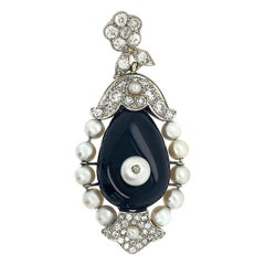 Cartier 18 Karat Gold Diamond Set with Onyx Pendant