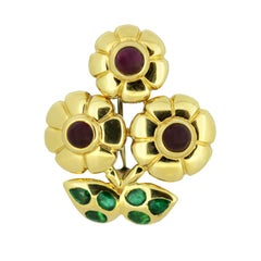 Cartier 18 Karat Gold Flower Brooch with Rubies and Emeralds