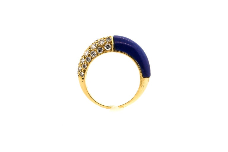 Vintage 18k Gold lapis and diamond ring by Cartier circa 1970. The lapis and the diamonds oppose each other on the finger. One side is set with 30 modern round brilliant diamonds weighing about 1.20 cts total. The ring is slightly domed and would