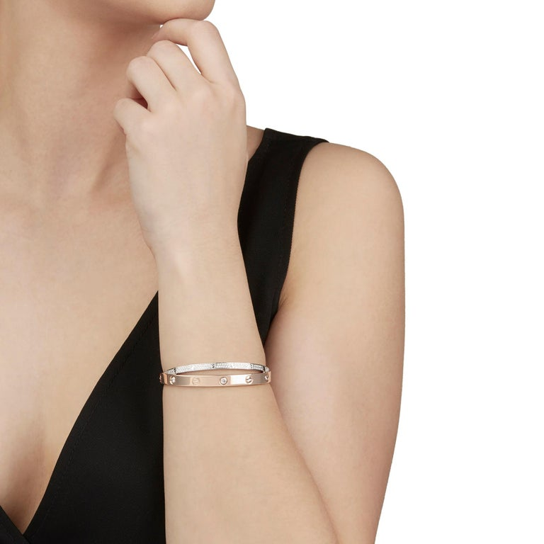 This Bracelet by Cartier is from their Love collection and features 114 round brilliant cut Diamonds of 1.47ct total colour E-F, clarity VVS mounted in 18k White & Rose Gold. The Bracelet has a screw clasp. Complete with Cartier Box & Purchase