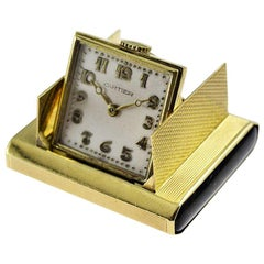 Cartier 18 Karat Solid Gold Desk Top Travel Watch with Onyx Buttons circa 1930s