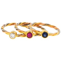 Cartier 18 Karat Tri-Color Sapphire Ruby and Diamond Stackable Rings