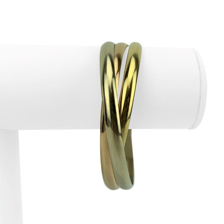Cartier 18 Karat Tricolor Gold Trinity Rolling Bangle Bracelet In Good Condition For Sale In Brandford, CT