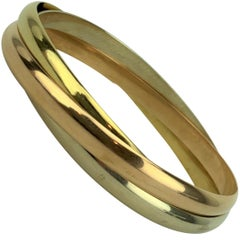 Cartier 18 Karat Tricolor Gold Trinity Rolling Bangle Bracelet