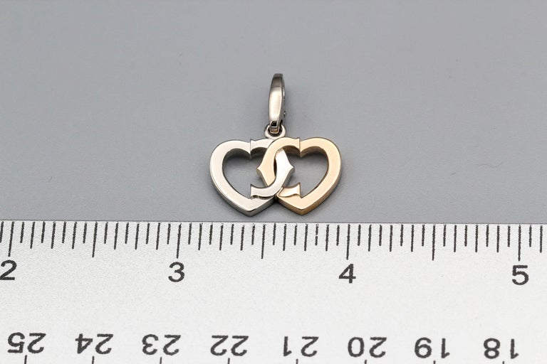 Cartier 18 Karat White and Yellow Gold Double Heart Logo Charm In Good Condition For Sale In New York, NY