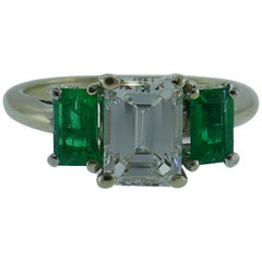 Cartier 18 Karat White Gold, 1.06 Emerald Cut Diamond and Emerald Ring GIA