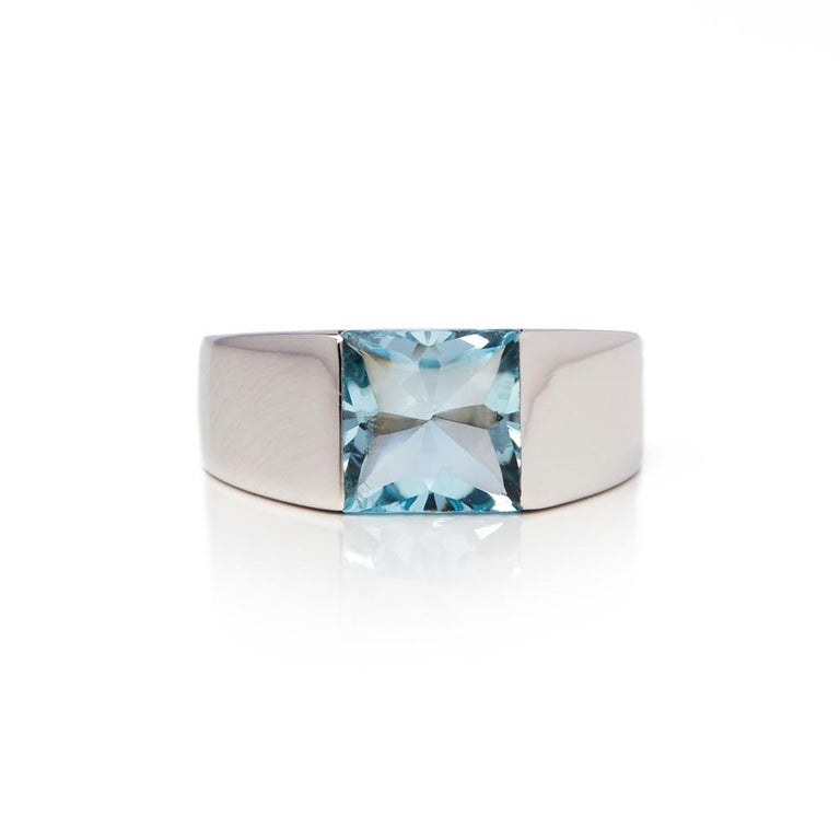 Code: COM1893 Brand: Cartier Description: 18k White Gold Large Aquamarine Tank Ring Accompanied With: Pouch Only Gender: Ladies UK Ring Size: M EU Ring Size: 53 US Ring Size: 6 1/4 Resizing Possible?: YES Band Width: 4.5mm Condition: 9 Material: