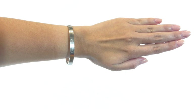 Cartier 18 Karat White Gold Love Bracelet. Signed Cartier, #KCF937, with purity marks. Circa 2010s. Size 18.   About The Piece: Get yourself the iconic and desirable look that everyone is on the hunt for. Cartier Love Bracelet is known for its bold