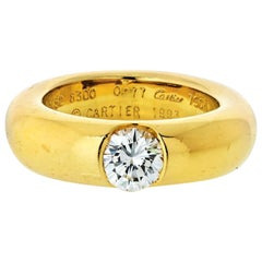 Cartier 18 Karat Yellow Gold 0.77 Carat Round Cut Diamond Engagement Ring