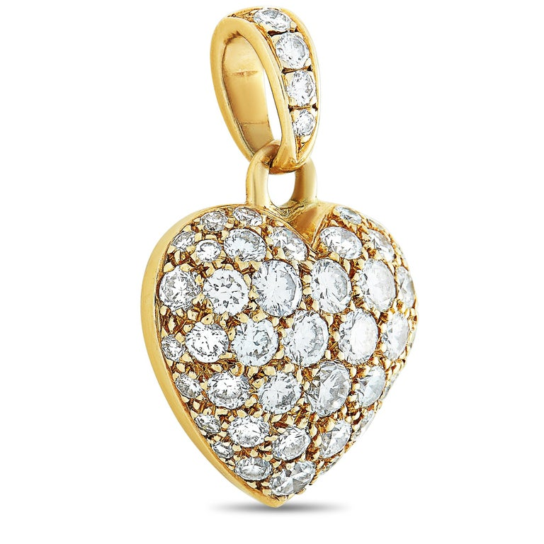 "This Cartier heart pendant is made of 18K yellow gold and weighs 3.1 grams, measuring 0.80"" in length and 0.50"" in width. The pendant is set with diamonds that boast grade F color and VS1 clarity and amount to 1.30 carats.    Offered in estate"