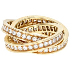 Cartier 18 Karat Yellow Gold and Diamond Trinity Rolling Ring
