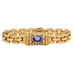 Cartier 18 Karat Yellow Gold Diamond Oval Blue Sapphire Link Bracelet