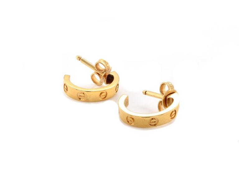 Designer: Cartier Material: 18K yellow gold Serial # DQD161 Weight: 3.00 grams