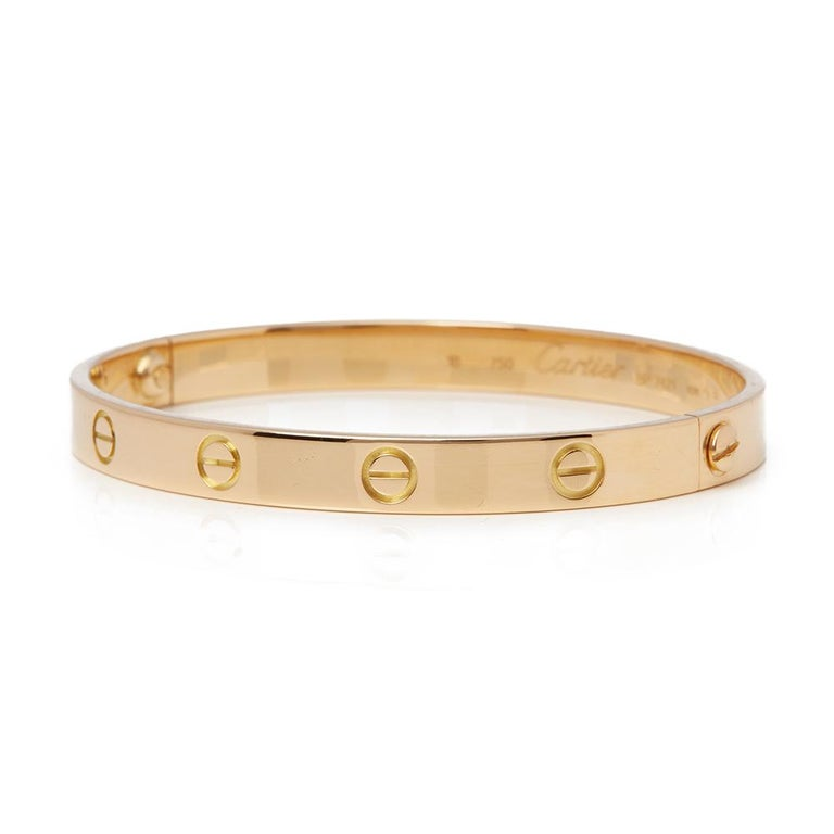 Xupes Code: COM1772 Brand: Cartier Description: 18k Yellow Gold Love Bangle Size 18 Accompanied With: Box & Papers Gender: Ladies Bracelet Length: 18cm Bracelet Width: 6mm Clasp Type: Screw Condition: 8 Material: Yellow Gold Total Weight: