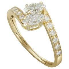 Cartier 18 Karat Yellow Gold Round and 2 Marquise Diamonds Bypass Ring