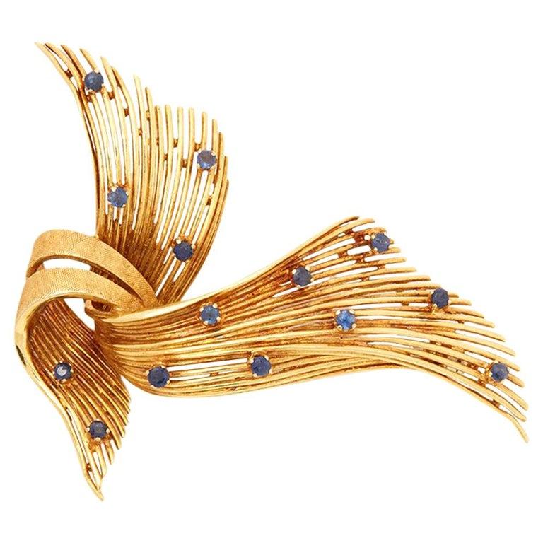 Cartier 18 Karat Yellow Gold Round Cut Sapphire Spray Vintage Ribbon Brooch