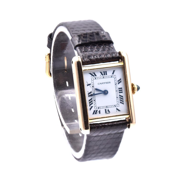 Movement: quartz Function: hours, minutes Case: 27 X20 mm rectangular case, push pull crown, sapphire crystal Dial: white arabic dial Band: black lizard strap with buckle Serial #: 780874XXX Reference: 21580  No box or papers Guaranteed to be