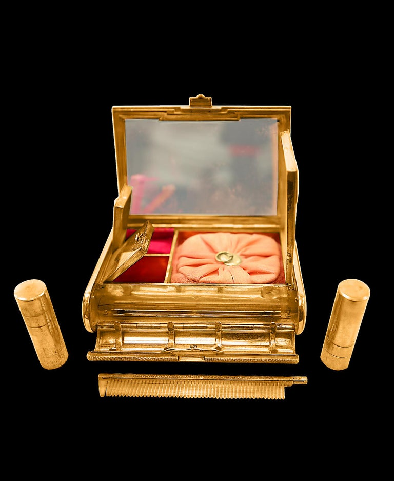 A beautifully crafted Vanity case by Cartier in 18-karat yellow gold from the Art Deco period of the 1930s Cartier - Art Deco 18-karat yellow gold vanity or compact box with diamonds (0.20 carat total)  Very unique and rare find . Box has an