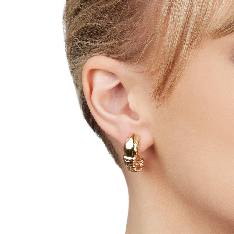 These Earrings by Cartier are from their Panthère collection and feature their signature Panthère design made in 18k Yellow, White & Rose Gold. The Earring length 2.5cm and the width is 8mm. These Earrings have secure lever backs. Complete with
