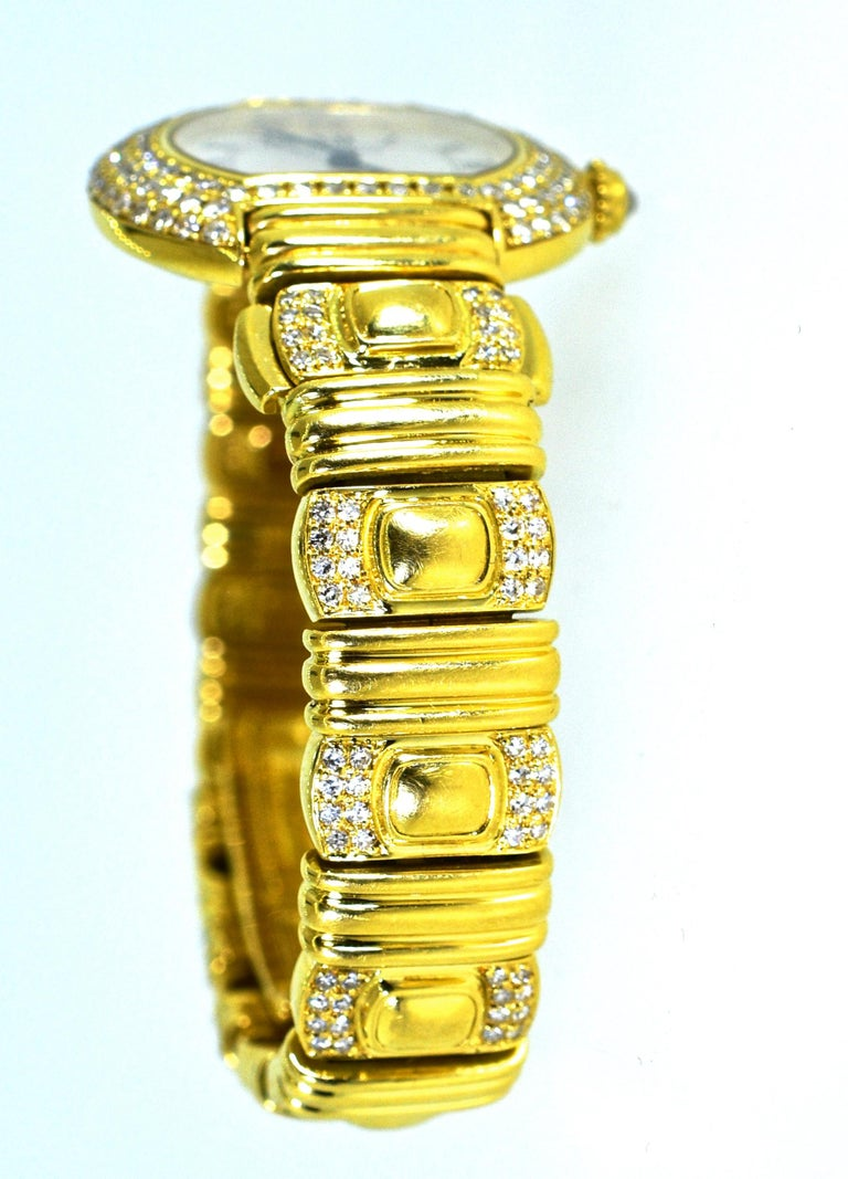 Cartier wristwatch or bracelet in 18K yellow gold with diamonds throughout, this watch bracelet can be worn with and without the watch.  Simply take out the watch and then put in the matching gold section and wear this piece just as a gold bracelet.