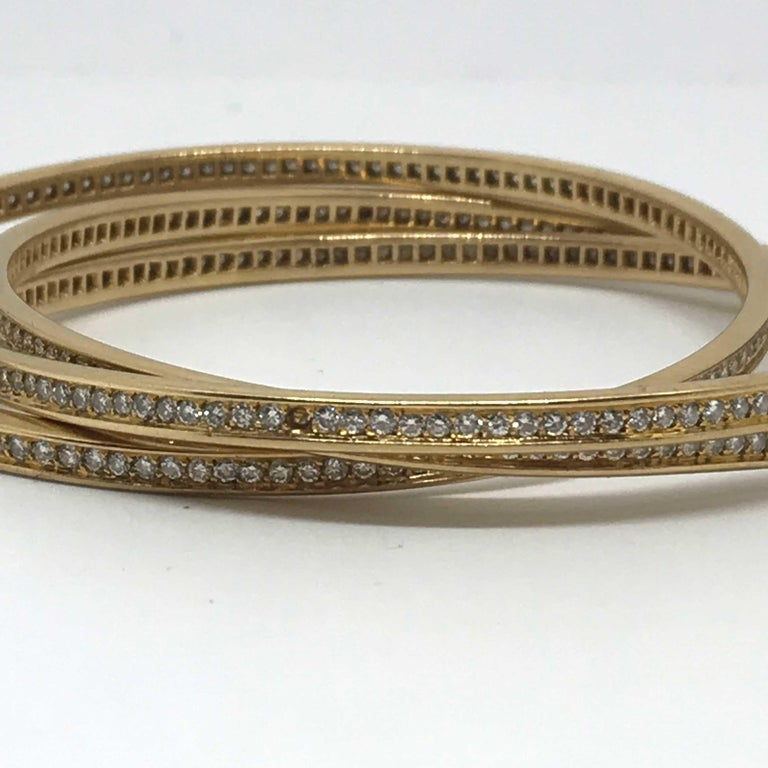 Amazing Vintage 3 Cartier bracelets in gold 18K. Cartier signature on it. One diamond is missing (see pictures) Original vintage one. Diameter : 6,7cm More than 320 diamonds, more than 6 carats Delivered without its original box.