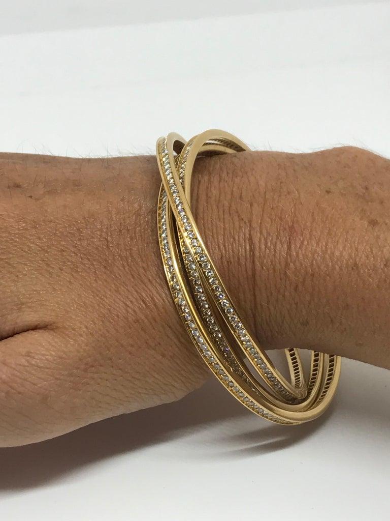 French Cut Cartier 18K Gold Trinity Bracelet For Sale