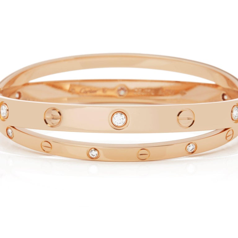 This Bangle by Cartier is from their Love collection and features Twelve Round Brilliant Cut Diamonds mounted in 18k Rose Gold. Size 16. Complete with Cartier Box and Original Warranty. Our Xupes reference is COMJ205 should you need to quote this.