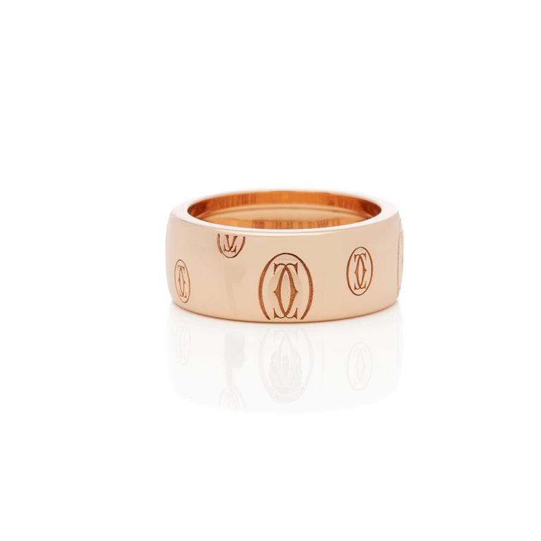 This Ring by Cartier is from their Happy Birthday Collection and Features the Cartier Motif Mounted in an 18k Rose Gold Band. Complete with Cartier Box and Original Cartier Warranty Paper. The Ring sizes are UK Ring Size: M, EU Ring Size: 52, US