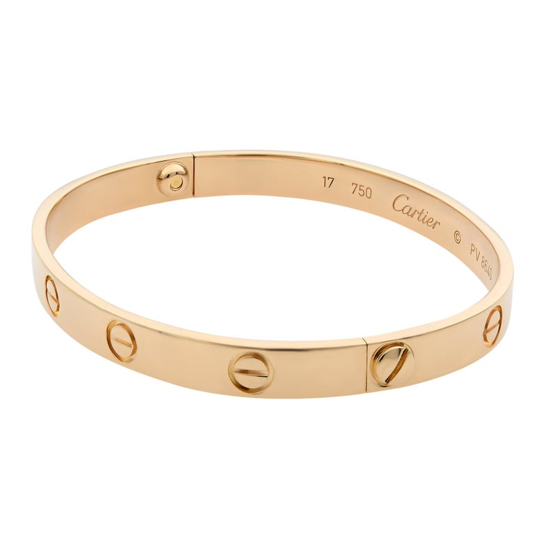 Cartier Love bracelet, 18K rose gold. Old screw system. Size 17. Condition: pre-owned, looks great. Comes with a screw driver. Box and papers are not included.