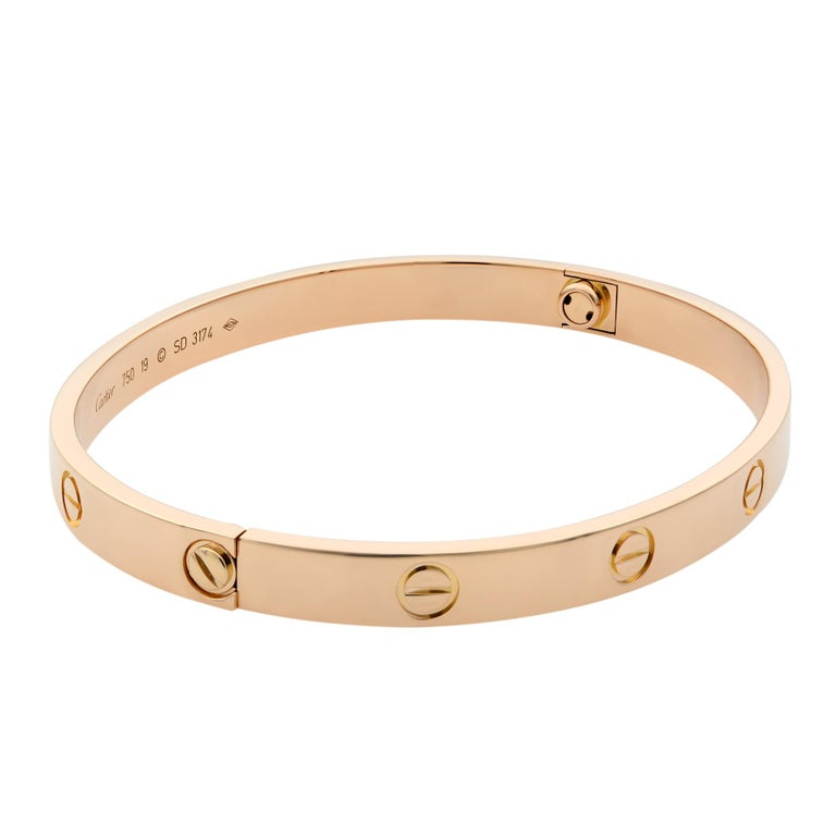 Cartier Love bracelet, 18K rose gold. Old screw system. Size 19. Condition: pre-owned, looks great. Comes with a screw driver. Box and papers are not included.