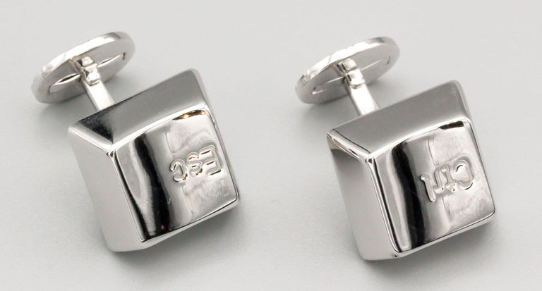 Unusual 18K white gold cufflinks by Cartier. They resemble computer keys, one side says