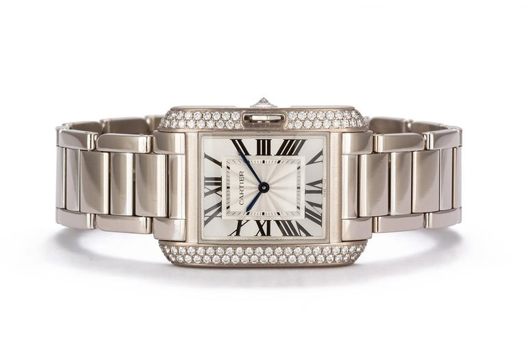 We are pleased to offer this Authentic Cartier 18k White Gold Tank Anglaise With Diamonds. The Cartier Tank Anglaise watch (ref. WT100028) features a Swiss-made quartz movement; silvered and lacquered flinqué dial with black Roman numerals and
